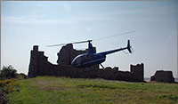 R44 taking off from Piel Island